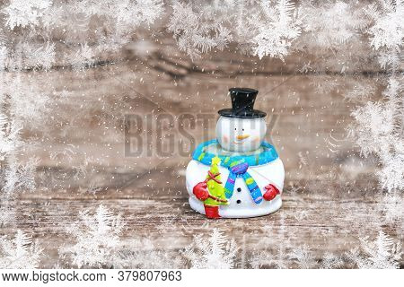 Close Up View Of Snowman In Winter Christmas Day On Wooden Background. Merry Christmas And Happy New