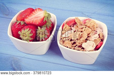 Fresh Strawberries, Wheat And Rye Flakes In Glass Bowl On Boards, Concept Of Healthy Lifestyle