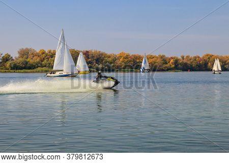 Jet Ski And Sailboats Sailing On The Dnieper River In Kremenchug, Ukraine