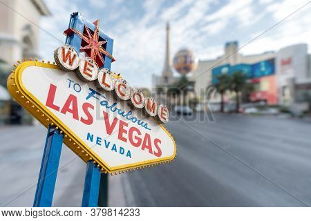 Las Vegas Sign with abstract blurred background of Las Vegas strip boulevard in Las Vegas city Nevada USA