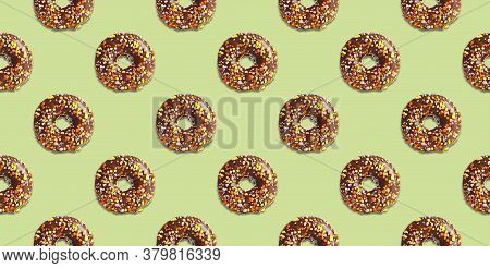Creative Pattern Design Of Glazed Donuts On Pale Light Green Background, Banner