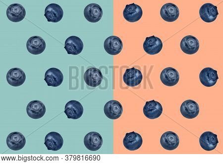Many Fresh Blueberries On Light Blue And Pale Coral Background. Pattern Design