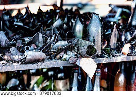 Close Up Damaged Supermarket Glass Plastic Bottles After Arson Fire With Burn Black Dark Debris Afte