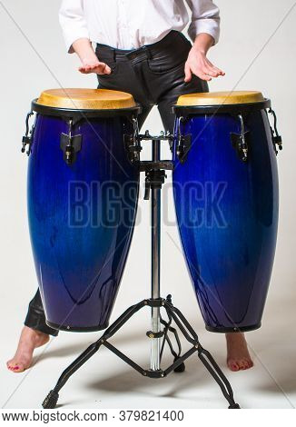 Close Up Of Musician Hand Playing Bongos Drums. Drum. Hands Of A Musician Playing On Bongs. Performe
