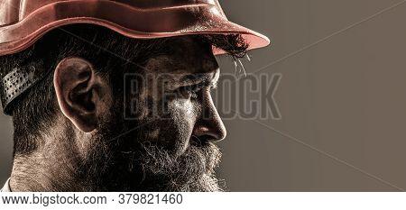 Portrait Of Handsome Engineer. Builder In Hard Hat, Foreman Or Repairman In The Helmet. Worker In Ha