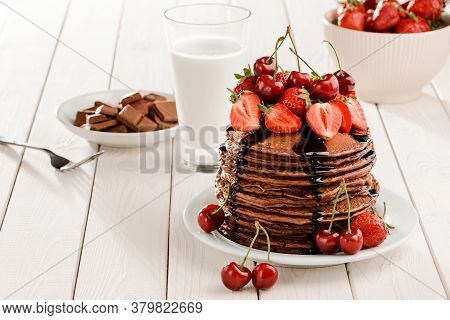 Pancakes With Berries And Chocolate Syrup Topping