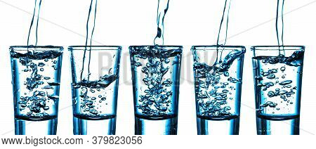 Five Vodka Shots In A Row. Transparent Alcohol Glass Background. Pouring Cold Vodka From Hight. Booz