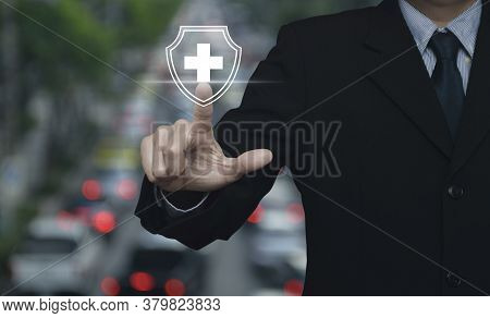 Businessman Pressing Cross Shape With Shield Flat Icon Over Blur Of Rush Hour With Cars And Road In