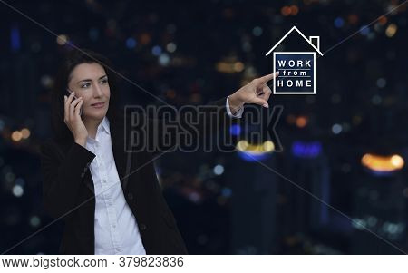 Caucasian Businesswoman Pressing Work From Home Flat Icon Over Blur Colorful Night Light City Tower,