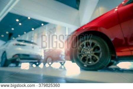 Blurred Suv Car Parked In Modern Showroom. Car Dealership And Auto Leasing Concept. Automotive Indus