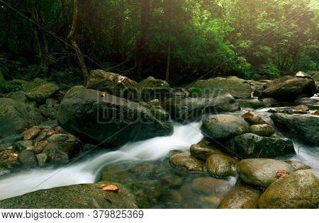 Beautiful Waterfall In Jungle. Waterfall In Tropical Forest With Green Tree And Sunlight. Waterfall