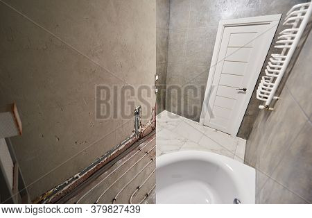 Modern Bathroom With Marble Floor And White Door Before And After Refurbishment. Comparison Of Old R