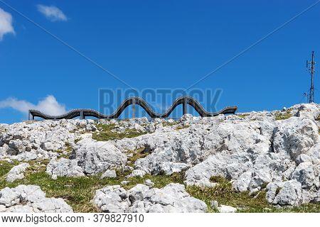 Abstract Wooden Chaise Longue In Mountains Dachstein Krippenstein In Austria