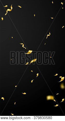 Streamers And Confetti. Gold Streamers Tinsel And Foil Ribbons. Confetti Explosion On Black Backgrou