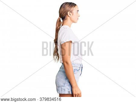 Young beautiful blonde woman wearing casual white tshirt looking to side, relax profile pose with natural face with confident smile.