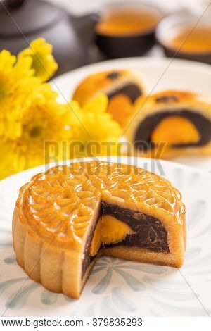 Tasty Baked Egg Yolk Pastry Moon Cake For Mid-autumn Festival On Bright Wooden Table Background. Chi