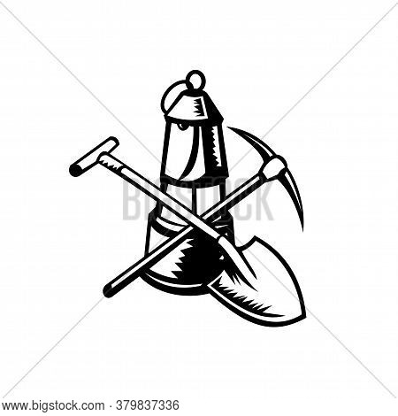 Retro Woodcut Style Illustration Of A Vintage Coal Miner's Lamp Or Davy Lamp With Crossed Spade Shov