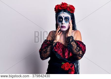Young woman wearing mexican day of the dead makeup tired hands covering face, depression and sadness, upset and irritated for problem