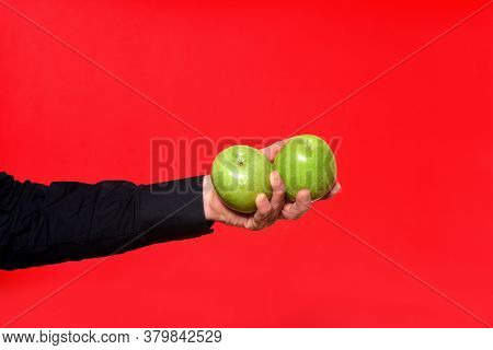 Hand Holding A Two Apple On Red Background, Green Apples