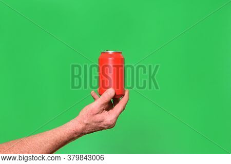 Man Holding A Can On Green Background