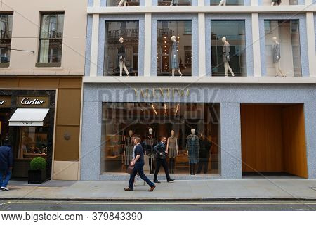 London, Uk - July 9, 2016: People Walk By Cartier And Valentino Fashion Shops At Old Bond Street In
