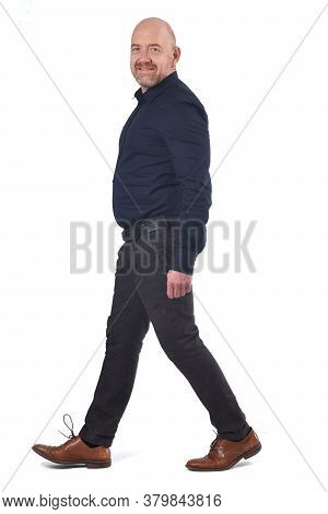 A Bald Man Walking On White Background