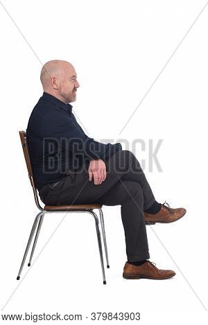 Portrait Of A Man Sitting On A Chair In White Background, Profile