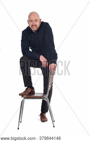Man Standing With A Chair In White Background, Foot Over The Chair