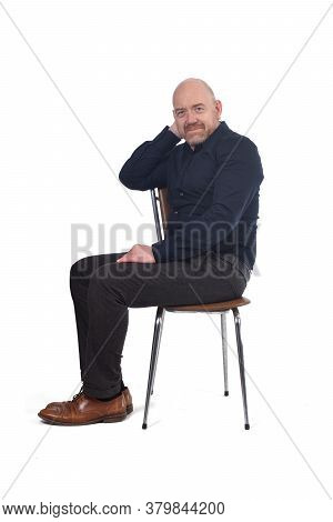 Bald Man Sitting On White Background, Hand On Face