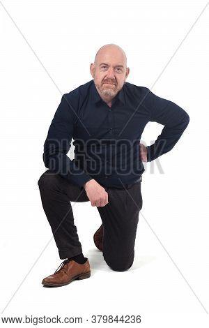 Full Portrait Of Man On Kneeson White Background