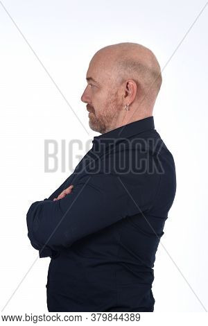 Portrait Of Profile Of  A Bald Man On White, Arms Crossed