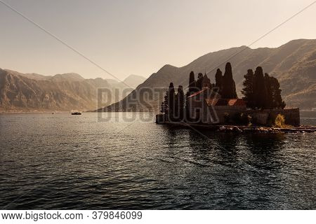Medieval Monastery And Cypress Trees On An Island In The Adriatic Sea.  Little Island In Kotor Bay A
