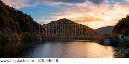 Sunset Panorama On The Tarnita Lake In Romania. Beautiful Nature Scenery In Autumn At Dusk. Gorgeous