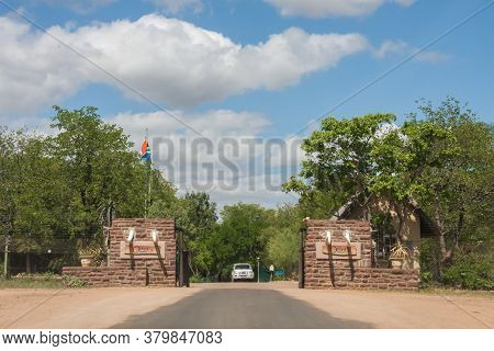 Olifants Restcamp Gate, Kruger National Park, South Africa, April 15, 2016: Vehicle Leaving The Olif