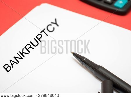 Close-up Of A Bankruptcy Petition On A Red Background.
