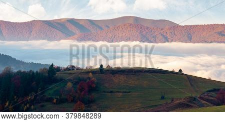 Cloud Inversion In Mountains. Carpathian Autumn Landscape. Hills In In Fall Colors And Morning Light