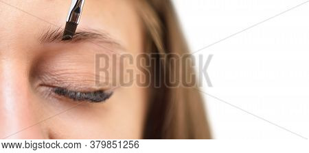 Young Woman Coloring Eyebrows With Henna On A White Background