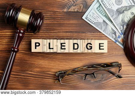 The Concept Of Pledge In Court Cases With The Judge Hammer.