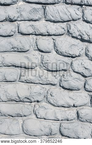 Fulframe Part Of A Wall With Gray Stonework. Old Castle Stone Wall Texture Background. Stone Wall As