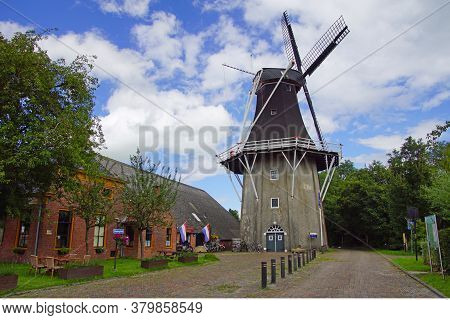 Eenrum, The Netherland - July 15, 2020: Historical Dutch Flour Mill 'de Lelie' And The Entrance Of T