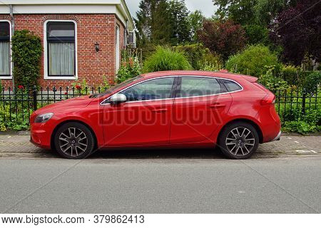 Pieterburen, The Netherland - July 16, 2020: Red Volvo V40 D2 Parked On A Public Parking Lot. Nobody