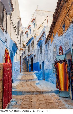Chefchaouen, Morocco - October 26, 2018: View Of A Picturesque Street Of The Blue City With A Weavin