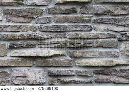Dark Grey Black And White Thin Cut Stacked Stone Block Wall With Shadows And Straight Lines Suitable