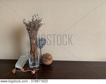 A Glass Vase With Lavender, A Heart And A Decorative Ball Highlight The Frosted Bottle Of Perfume. F