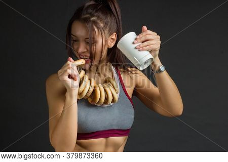 Young Fitness Woman In Training Topic There Are Bagels With Tea