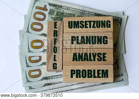Problem, Analyse, Planung, Umsetzung - Words On Wooden Bars Against The Background Of Banknotes. Bus