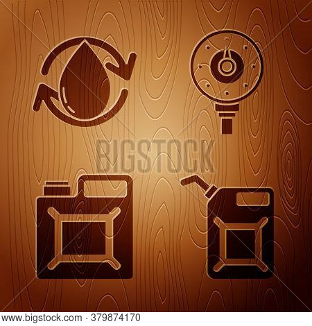 Set Canister For Gasoline, Oil Drop, Canister For Gasoline And Motor Gas Gauge On Wooden Background.