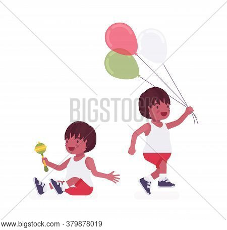 Toddler Child, Black Little Boy Enjoying Playing With Rattle Toy, Balloons. Cute Sweet Happy Healthy