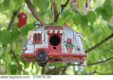 Little Silver Camper Bird House Hanging From Tree Branch