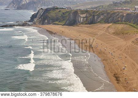 Spanish Sandy Coastline With Surfers. Sopelana, Basque Country, Spain